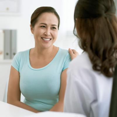 Female patient smiling with her physician.